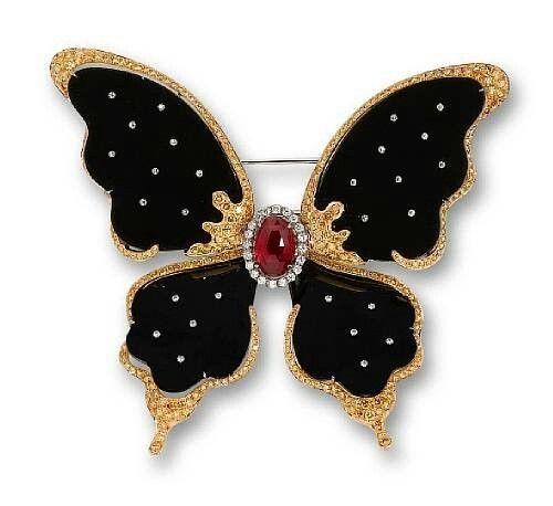 A black jadeite, ruby, and diamond butterfly brooch