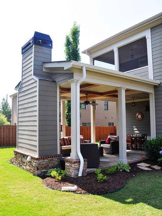 Outdoor covered patio with fireplace, great addition idea. Screen the upstairs patio & just add on the covered bottom area. Might be cheaper than a large upper deck.
