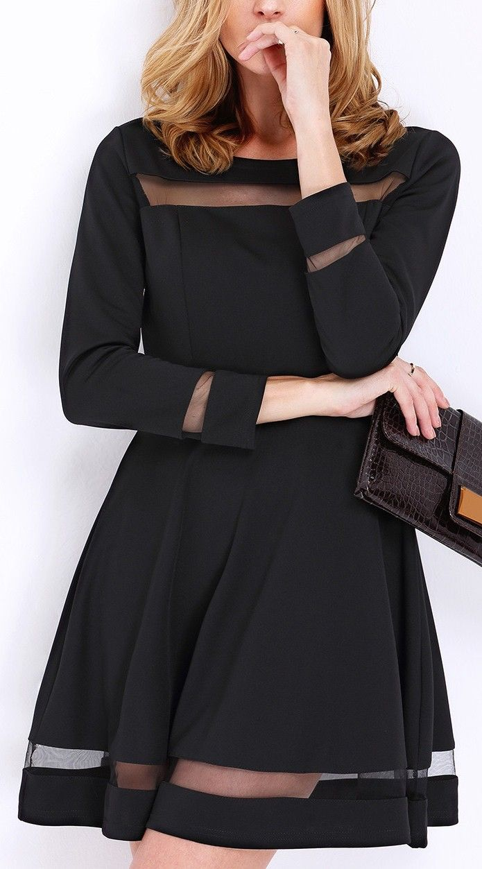 Show off your style in this black long sleeve contrast mesh dress