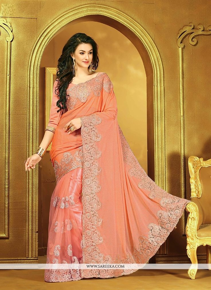 Bring out the true diva in you and reinvent your true self. Add grace and charm to your appearance in this beautiful peach faux chiffon designer saree. The lovely embroidered and patch border work thr...