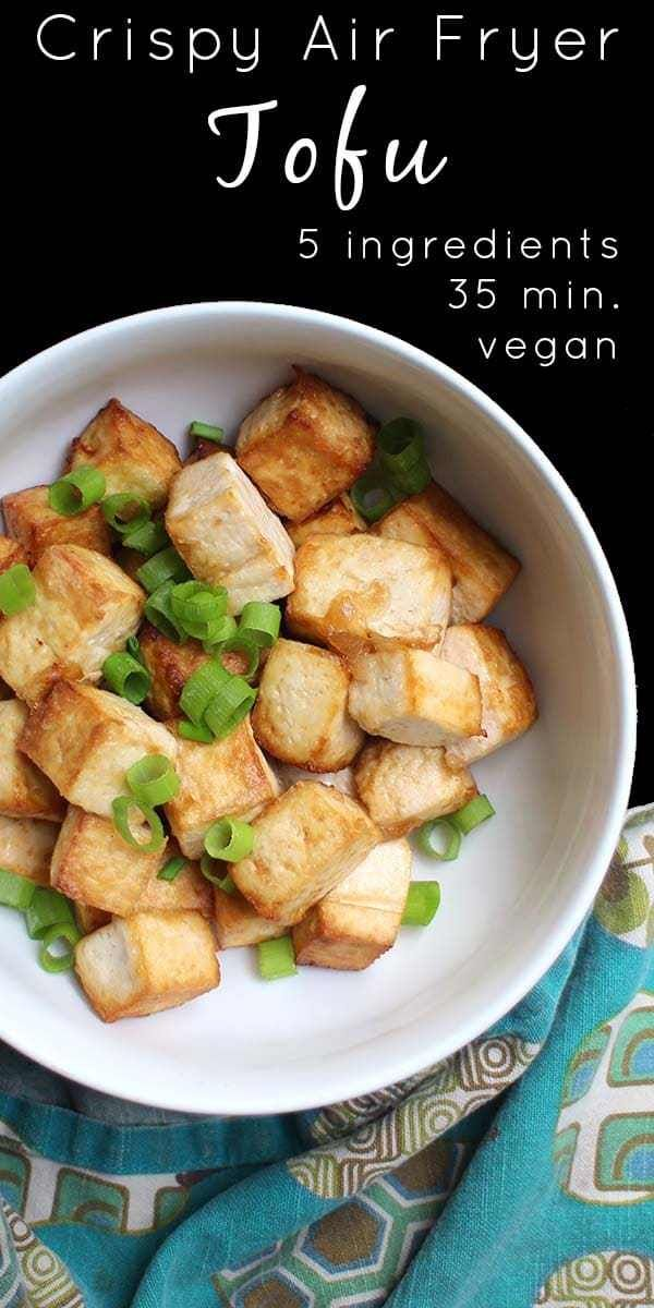 Crispy Air Fried Tofu is lightly crispy, deliciously chewy, and perfect for topping salads or comfort bowls or for stuffing into wraps.  #airfryer #tofu #vegan #veganairfryer
