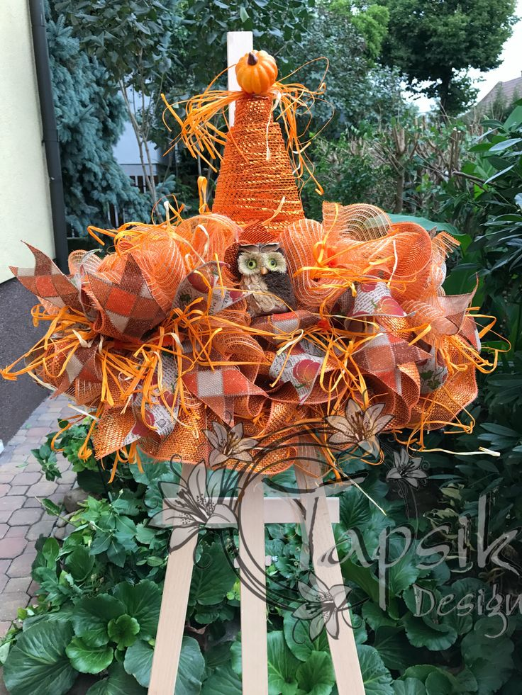 Something different and new for your front door. Scarecrow wreath. It can hang on your front door through the whole fall season. Base orange deco mesh, 2 kinds of ribbon strips, raffia, one owl and pumpkin. Around 63 cm (25 inch) wide, up to 53 cm (21 inch) tall.
