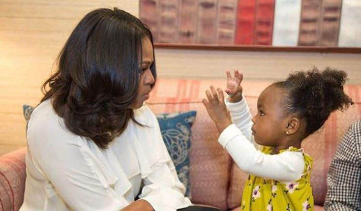 Michelle Obama meets the 2-year-old who was captivated by her portrait and they danced. And the internet went crazy at the sight of the former first lady and Parker Curry, age 2, talking and dancing together.