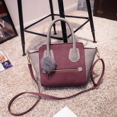 Hand and shoulder bag in Leather with Fur