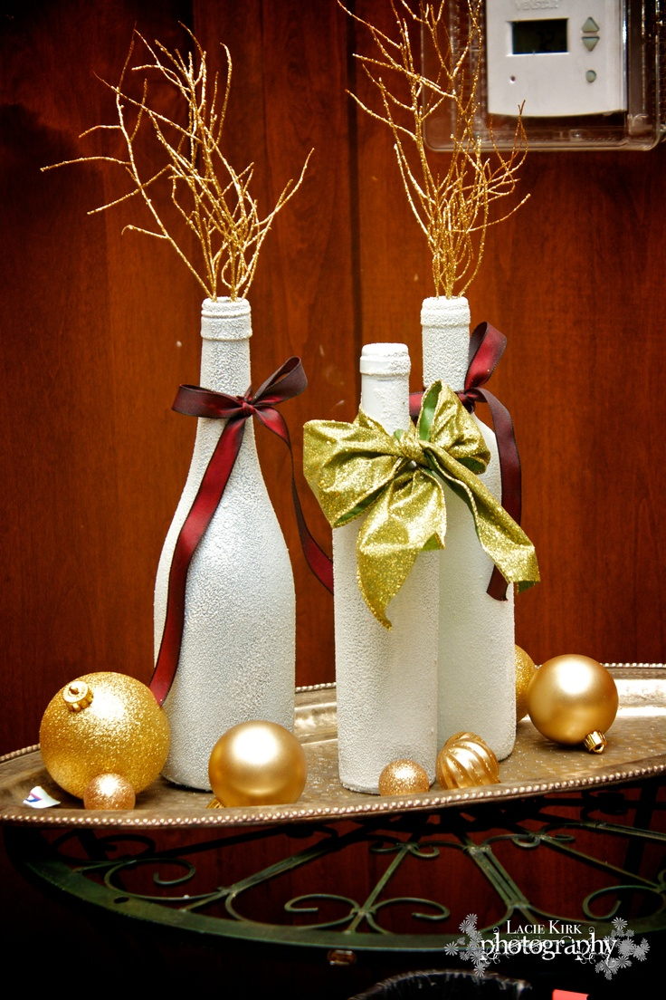 Beer bottles, Mason jars  Wine bottles painted or wrapped with twine or ribbon in clusters for center pieces?