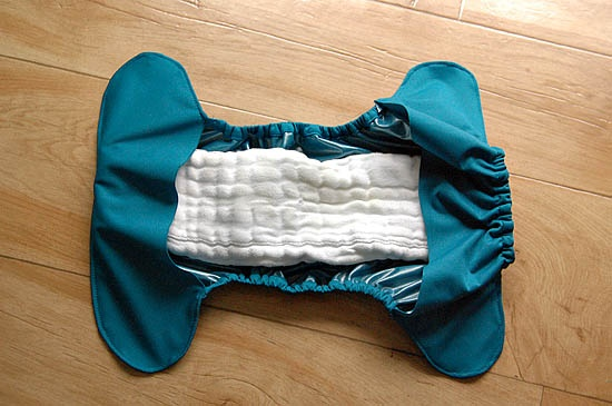 great tutorial on how to convert a diaper pattern to a flap diaper cover made of pul that lets you just lay the soaker inside. I like the method of covering the elastic with the pul so that you don't actually stitch the elastic down the entire lenth.