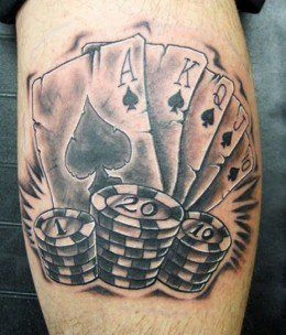 """This is a Temporary tattoo of a black and white low rider car surrounded by flames, a pair of dice, playing cards, and a ribbon that reads """"life's a gamble"""". Description from pinterest.com. I searched for this on bing.com/images"""