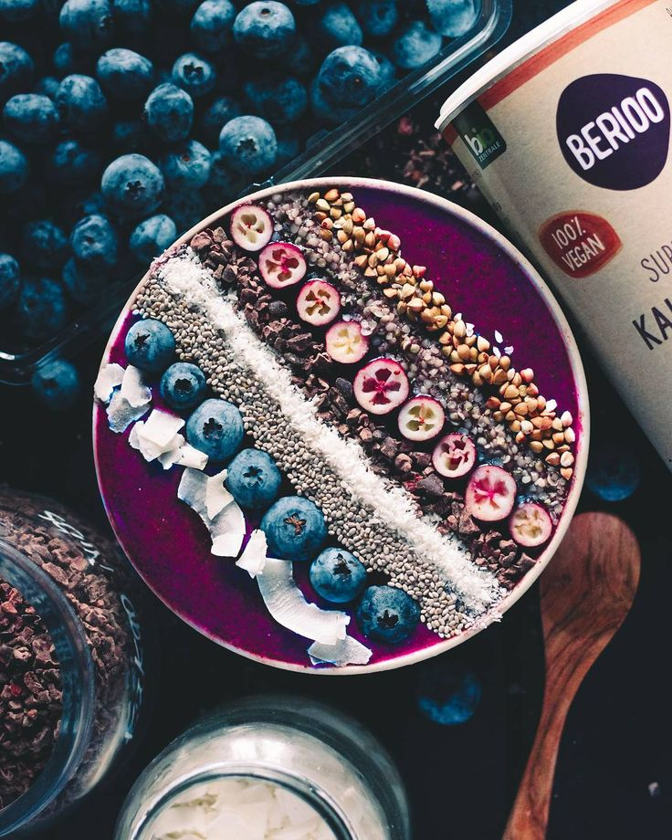 Acai bowl topped with buck wheat, hemp seeds, cranberries, cacao nibs, coconut, chia seeds, blueberries and coconut chips. Ingredients for one bowl: 1 apple; 1 cup frozen blueberries; Optional: 1 banana; 1 tsp acai powder; 150 ml water. Blend and enjoy