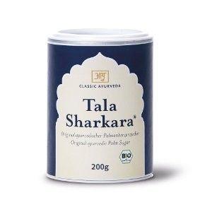 Tala Sharkara  Description: Palmhartsuiker (Tala Sharkara) is een waardevol voedingsmiddel in de tradtie van Ayurveda. Het sap van de bloesem van de Palmyra palm wordt ingedikt gedroogd en daarna vermalen. Het product bevat de waardevolle bestanddelen van het plantensap:Tala Sharkara is ongeraffineerd en rijk aan mineralen vitamines en organische zuren.Met zijn typische caramelachtige geur is Tala Sharkara bijzonder lekker ook voor kinderen. Palmhartsuiker is bij uitstek geschikt voor het…