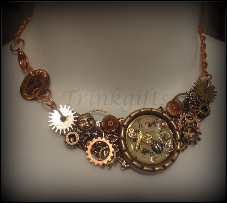 Steampunk Necklace - By Trinkgifts Gears/components mounted on a crescent made of grungeboard.
