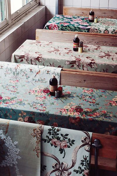 Love the idea of using various floral fabric table covers for a wedding!