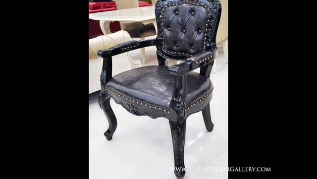 Add some French Elegance to your home with this fabulous French Rococo accent black arm chair. Solid rubber wood frame hand finished in black lacquer with fabulous hand carvings. Upholstered in dark espresso leather with fabulous hand carvings.  Features: Upholstered accept arm chair in luxurious black finish. Beautiful hand carving using natural solid Rubber wood. Comfortable height. Have beauty and rest at your home or business Multi-use chair as accent chair, lobby chair, dining chair…