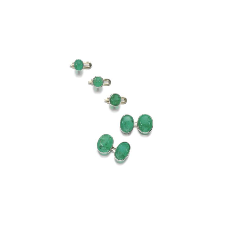 Emerald dress set Comprising: a pair of cufflinks each collet set with an oval cabochon emerald, to an oval connecting link and three matching buttons.