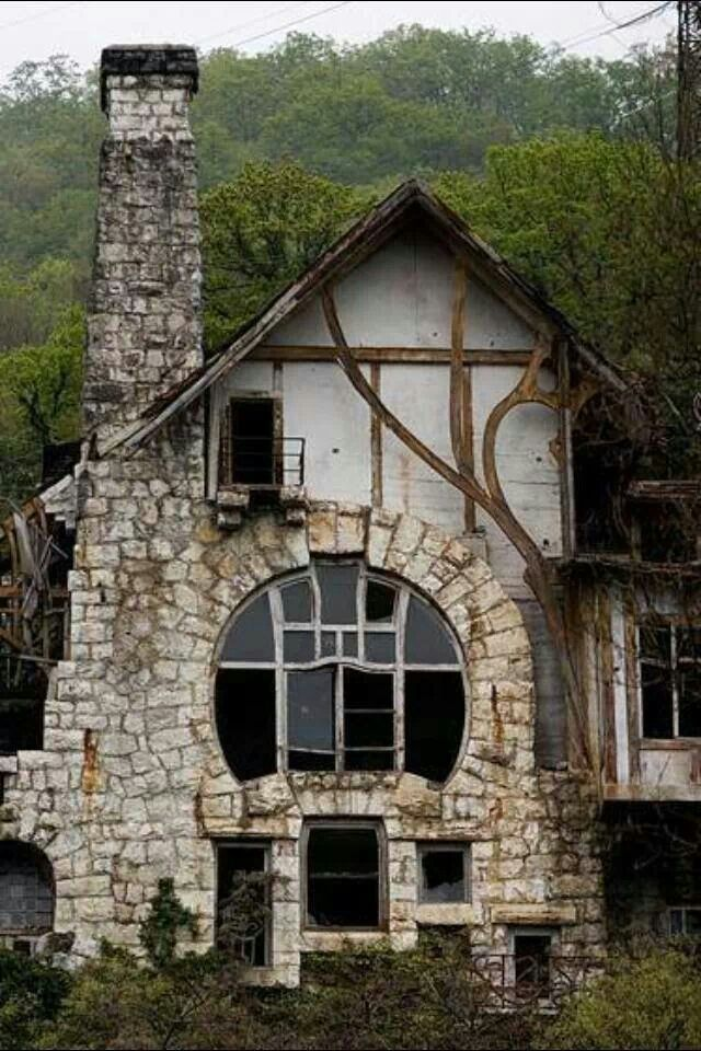 Abandoned house with gorgeous round window.