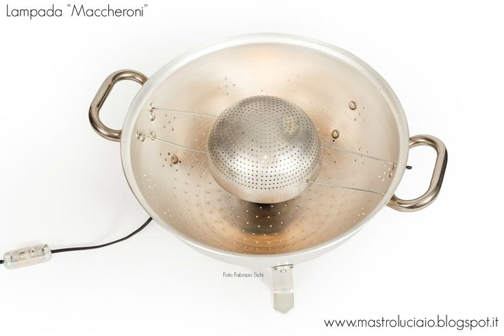 """Maccheroni"" lamp, made with a big colander and a smaller strainer, both of them are very old and used. Steel wires from an old Vespa. #colander #aluminum #lamp #vintage #redesign #handicraft #recycle #reuse #artigianato #lampade #lights #luci #handmade"