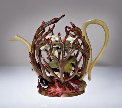 My favorite teapot from this website.  Many beautiful ones pictured.  This is one is called the Trillium Teapot.  Made from wood.