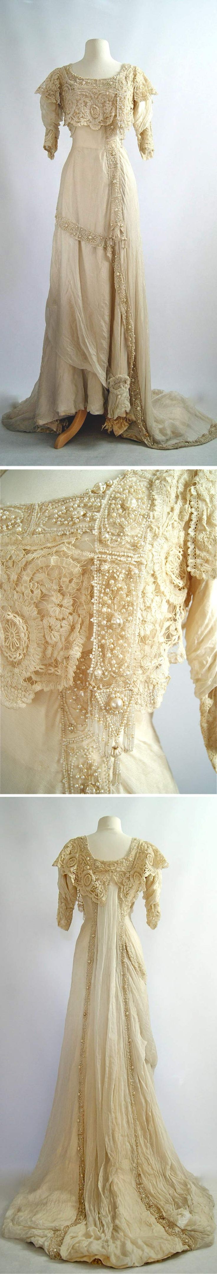 "Evening gown ca. 1900s. Silk. Scoop neck trimmed with lace & beading around collar. Lace cascades down left side. Beading down left side & across lower waistline that leads to 2 panels in back with detailed beading. Front is 24"" higher than back. Sleeves are 3/4 length & slightly gathered with lace at cuffs. Boned bodice plus built-in corset that has hook & eyes in back. Dress closes with many hook & eyes in back. xtabayvintage/etsy"