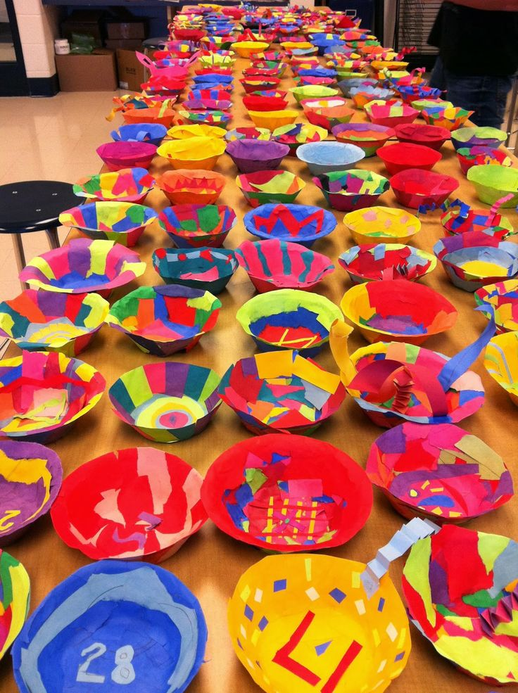 7th Grade- Dale Chihuly's installation work as inspiration. Use scraps of paper, art paste and styrofoam bowls. Dip scraps into paste then layer it onto the bowls, once dried (next day) the paper bowl/flower pops right out. Display on ceiling.