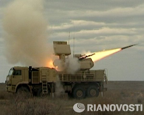 The Pantsir-S1 is a short to medium range surface-to-air missile and anti-aircraft artillery system which was designed in 1994 in Tula, Russia. Although the Pantsir-S1's combat range is only 20 km, it can fire missiles to an altitude of 15 km and target all types of aircraft, helicopters, drones, cruise missiles, and air-to-ground precision-guided weapons. Above: Pantsir-S1 in action during military drills near Astrakhan, Russia.