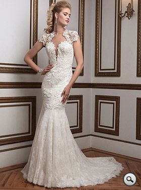 Justin Alexander 8796 // Fit-and-flare bridal gown in Venice and Chantilly lace with stunning jewelled neckline. Beautiful sheer back detailing with buttons. Scalloped lace at the hem. Chapel length train.