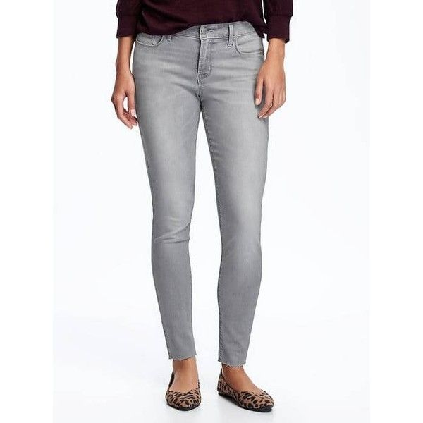 Old Navy Womens Mid Rise Grey Wash Raw Hem Rockstar Jeans ($31) ❤ liked on Polyvore featuring jeans, granite, petite, denim skinny jeans, super stretch skinny jeans, white super skinny jeans, super skinny jeans and faded skinny jeans