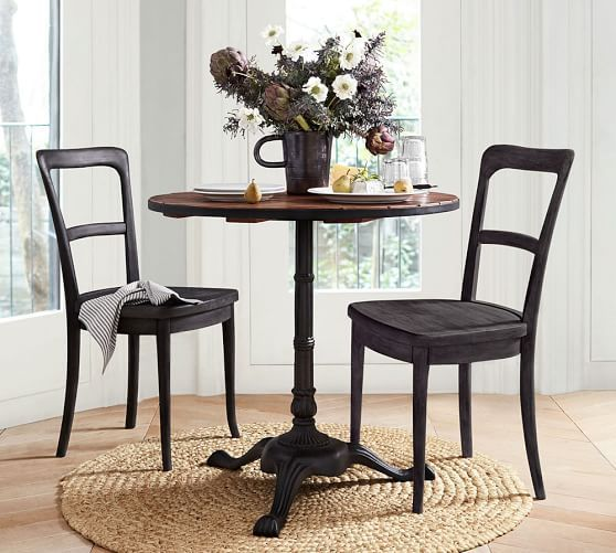 Small-space dining can still look good. The Cline Dining Chair is modeled after a vintage style, with simple curved details along the back. Three color options let you mix and match or pick the best option for your home.