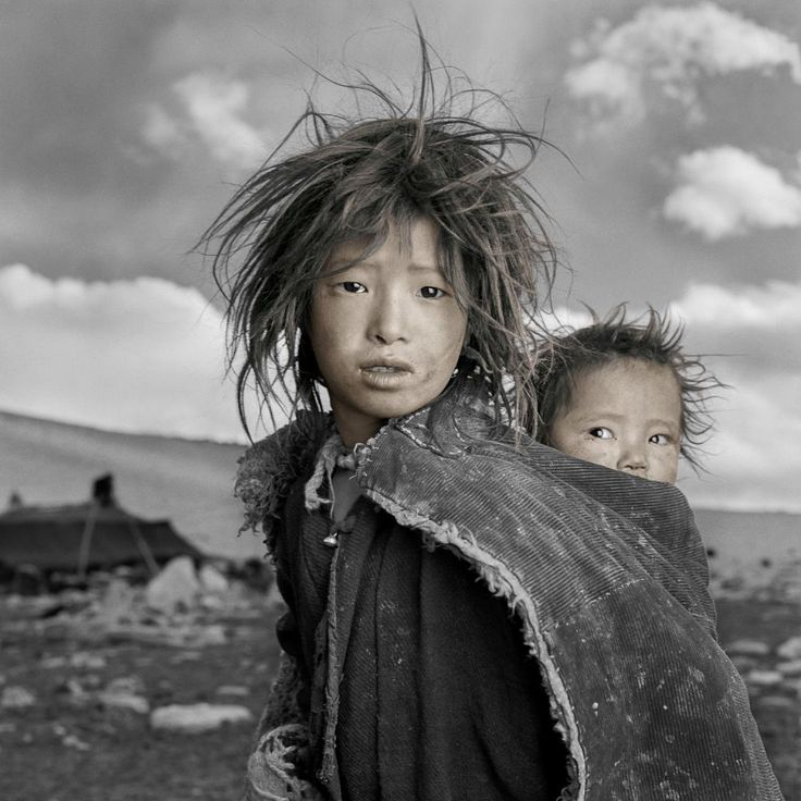 Jigme and Sonam are sisters whose nomadic family had just come down from the Himalayan highlands to their 16,500 ft. winter camp on the Tibetan Plateau. When I gave Jigme a Polaroid of herself she looked at it, squealed and ran into her tent. I assumed that this was one of the only times she had seen herself since her family did not own a mirror.  Jigme means 'fearless' and Sonam means 'merit'. Very appropriate names for these kids!