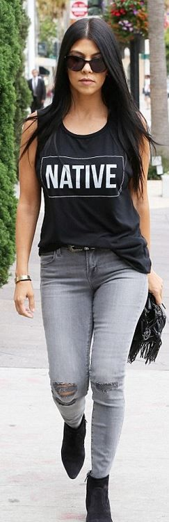 Who made  Kourtney Kardashian's black fringe handbag, gray skinny ripped jeans, and suede ankle boots?