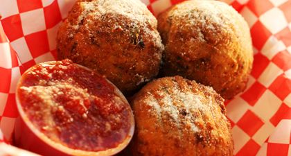 Arancini (Crispy Risotto Balls)  Recipe from: Chef Joe Youkhan's Tasting Spoon  It's time for some delicious, gourmet Italian comfort food at The Tasting Spoon truck in Orange County, where they serve Crispy Buttermilk Marinated Calamari, Arancini and even a Foie Gras Slider.