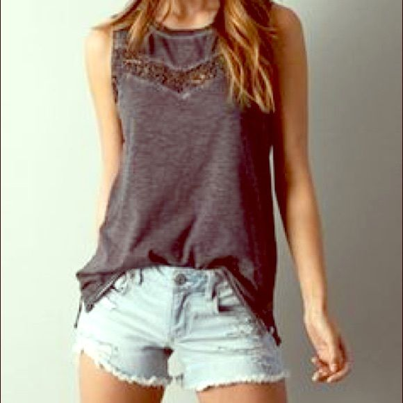 American Eagle grey muscle tee Grey muscle tee from American Eagle. Holes with a flower pattern at the top along the bra line, but works best with a low cut bra. American Eagle Outfitters Tops Muscle Tees