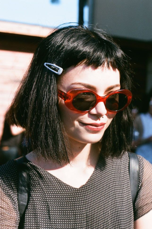 Choppy baby bangs, micro fringe cut just below the hairline from a small section at the front. Black blunt babydoll bob. Medium to large forehead.