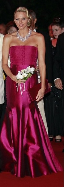 HSH Princess Charlene looks wonderful in this strawberry fuchsia gown. Love the neclace.