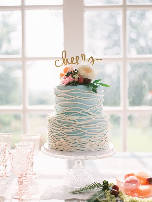 Blue Wedding Cake With Piping Of White Organic Lines