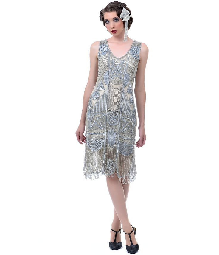 Sweet, sophisticated and undeniably sultry, The Bosley silver beaded flapper dress from Unique Vintage is a true vintage recreation with a modern edge. Whether you're looking for a unique dress for prom or homecoming or a perfectly retro frock to wear to a formal work event, this intricately decorated 1920s-style dress is a stunning choice that will flatter any figure. Its shift shape is covered with elaborate art deco swirls, flowers and linear shapes made of soft silver beading, and it has…