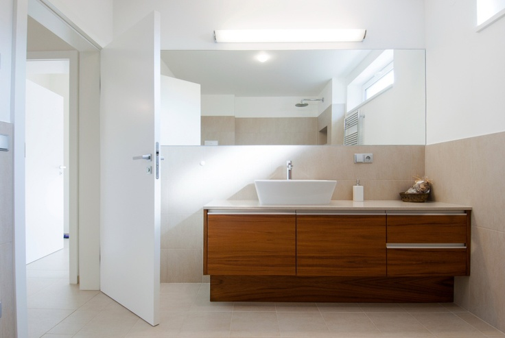 Teak veneer is completely safe for the bathroom when it gets the right surface treatment to block it from moisture. We are building in a wide range of sanitary devices into our bathroom furniture. (architect: Ivan Zachar)