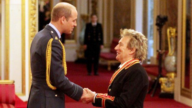 """Talk about """"A [Knight] on the Town"""" for Rod Stewart.The 71-year-old music legend was knighted today, becoming Sir Roderick David Stewart at Buckingham Palace for his accomplishments in the industry and beyond.Slideshow: Stars With Their FamiliesRead: Rod Stewart Chosen for Knighthood by Queen ElizabethStewart was knighted by Prince William. The """"Forever Young"""" singer was joined by his wife, Penny Lancaster, and two of his sons — Alastair and Aiden. The boys were dressed to the nines, as was…"""