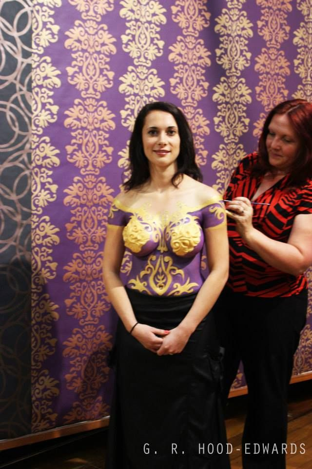 Pink Ribbon Calendar exhibition opening featuring body painting.