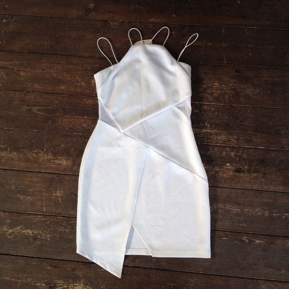 NWT white bodycon halter dress Adorable all white bodycon dress with both spaghetti and halter straps, also has mesh slits on sides. NWT Dresses