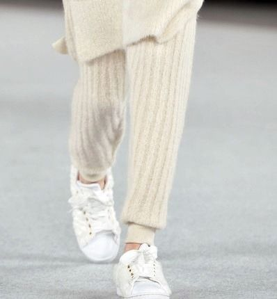 Buy cashmere pants and trainers in white, ivory, or black.