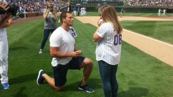 After Olympic gold medalist Shawn Johnson threw out the first pitch for the Chicago Cubs at Wrigley Field on Friday, her boyfriend dropped to one knee and popped the question. Her boyfriend — now fiancee — is a long-snapper for the Kansas City Chiefs.
