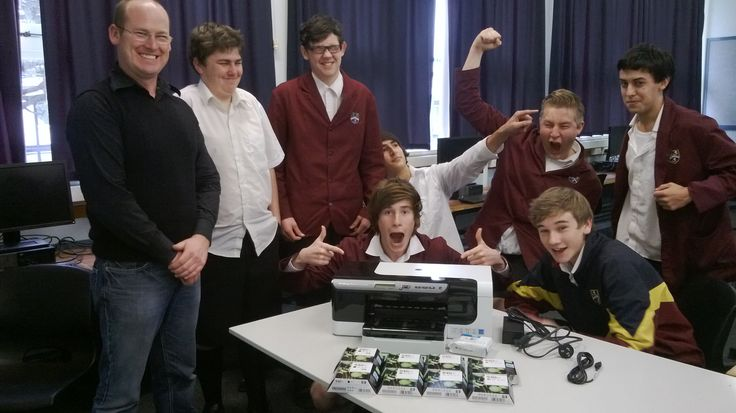 Troy Smith and his Year 12 computer class receive a new printer, thanks to INTERFACE and our good friends at HP.