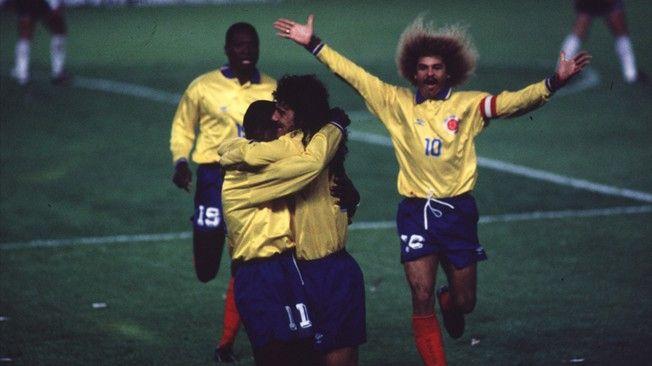 Colombian players Leonel Alvarez (R) and Faustino Asprilla celebrates while Carlos Valderrama and Freddy Rincon joins in 1993(Courtesy of Revista El Grafico)