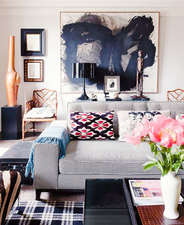 If you don't have a fireplace or a window with a view, use a large piece of artwork as the focal point of the room.