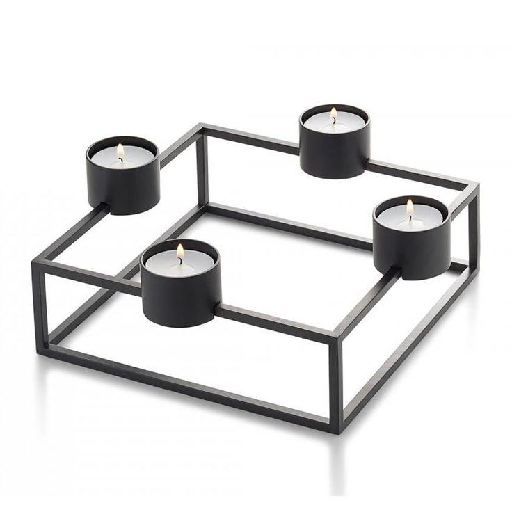 Ένα κηροπήγιο με τέσσερα ρεσώ, από σκούρο καφέ μαγνητικό σκελετό, Υλικό: ατσάλι με μαγνητική σκόνη