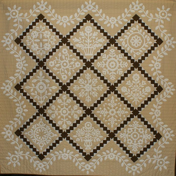 """1011Tommie Crocker - Whitework sampler - applique quilt - 2 or more persons.  Judging.  . 79x79 """"Hand Applique 2010. The machine quilted Cynthia Clark Whitework sampler Rabbit Factory -. Kingston, Ontario, Canada."""