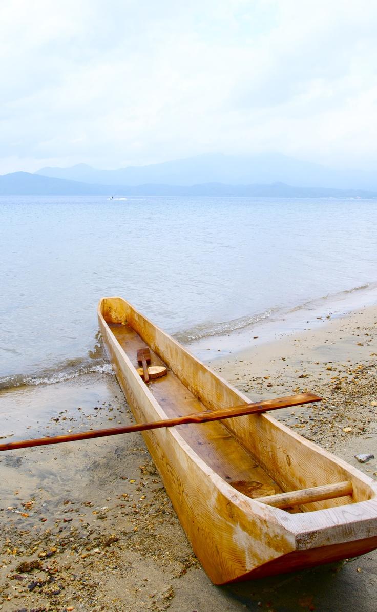 Tazawa lake and pine tree boat.