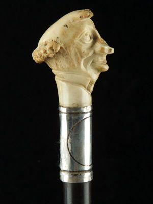 an amusing grotesque cane modelled as Disraeli English date circa: 1900