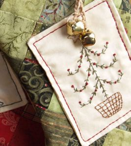 Each Christmas stocking has an embroidered panel which I hand appliqued to the front. The bow and brass bells were a last minute inclusion.