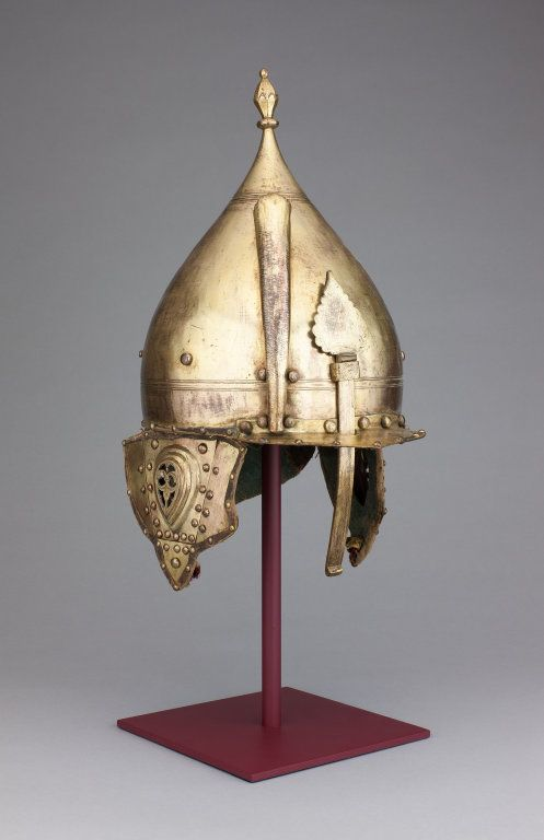 Ottoman tombak (gilded copper) chichak, 17th century, a type of helmet (migfer) originally worn in the 15th-16th century by cavalry (sipahi) , consisting of a rounded bowl with ear flaps, a peak with a sliding nose guard passing through the peak, and an extension in the back to protect the neck. Various other countries used their own versions of the chichak.