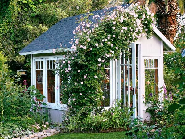 This garden cottage is more playhouse than greenhouse for its Central California owner. The avid gardener raises seedlings and overwinters orchids here. Comfort was a major factor: The shed is designed to let in plenty of daylight while minimizing prolonged exposure to direct sun during the Central Valley's very hot summers. It is oriented slightly off a direct east-west axis and its most westerly wall is solid. Prefab siding covers the wood frame; asphalt tiles cloak the roof. A 'Cecile…